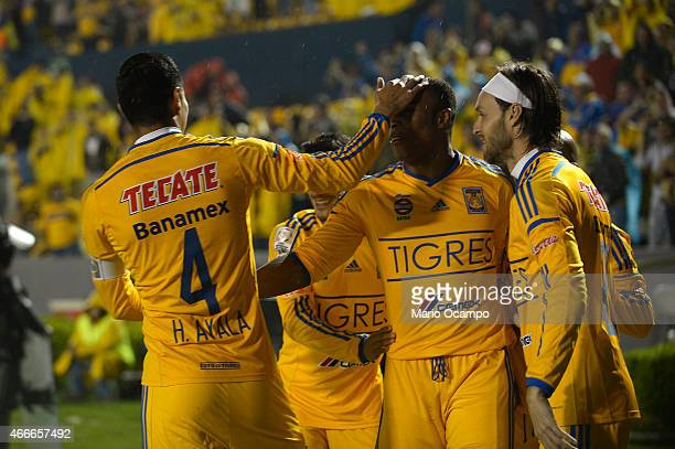 Joffre Guerron of Tigres celebrates with teammates after scoring his team's first goal during a group 6 match between Tigres UANL and San Jose Oruro...