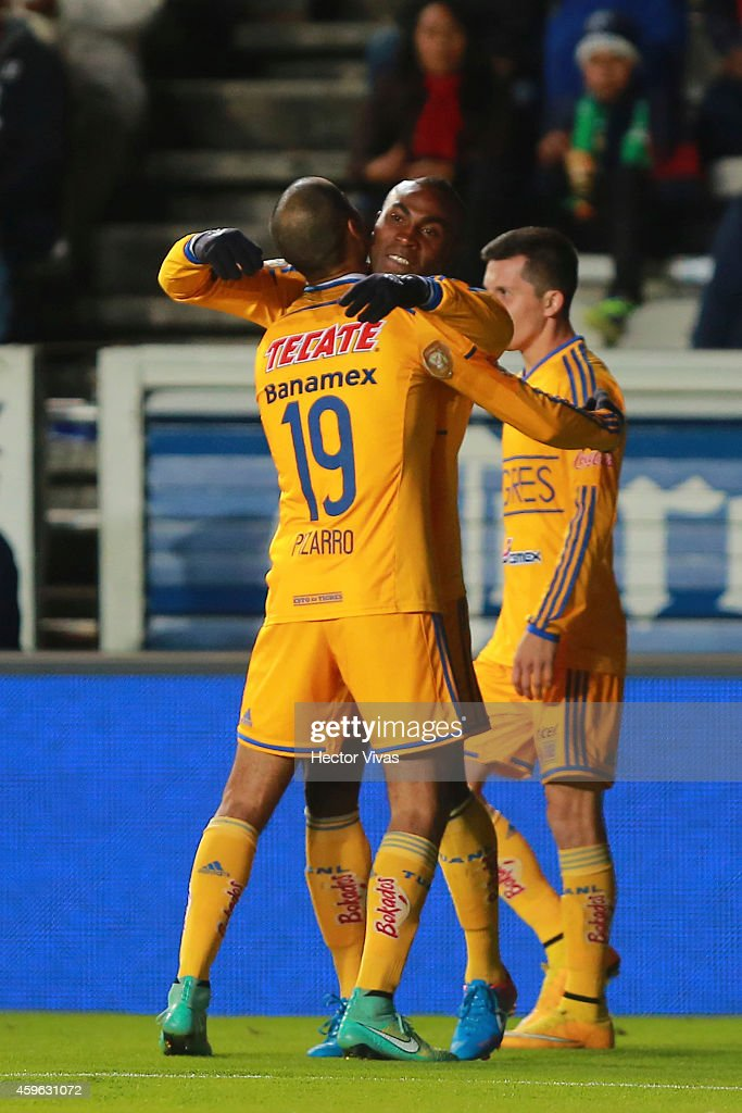 Joffre Guerron of Tigres celebrates with teammates after scoring the first goal of his team during a quarterfinal first leg match between Pachuca and...