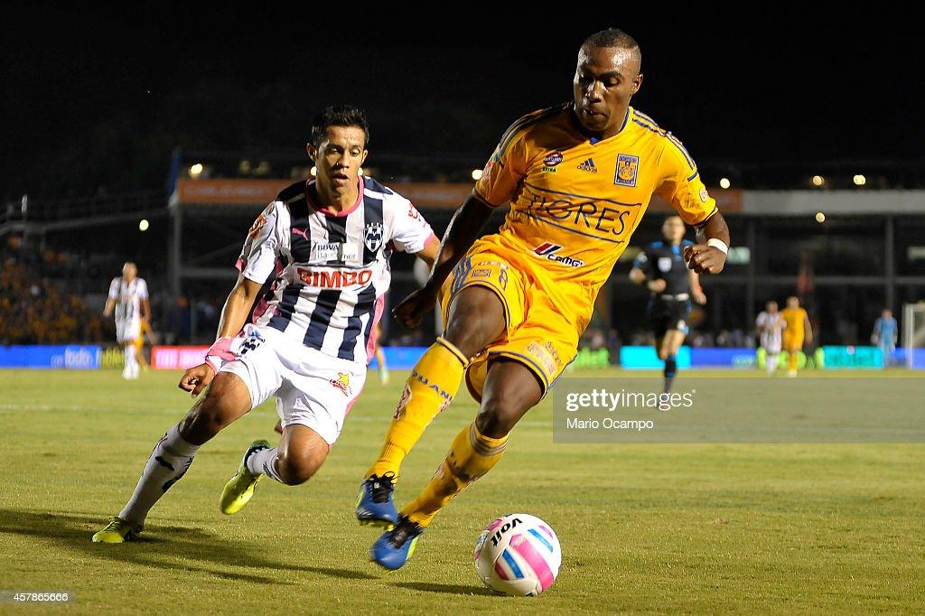 Joffre Guerron of Tigres drives the ball as Severo Meza of Monterrey follows him during a match between Monterrey and Tigres UANL as part of 14th...