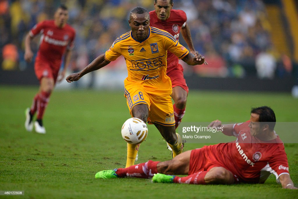 Joffre Guerron of Tigres fights for the ball with Aaron Galindo of Toluca during a semifinal second leg match between Tigres UANL and Toluca as part of the Apertura 2014 Liga MX at Universitario Stadium on December 07, 2014 in Monterrey, Mexico.