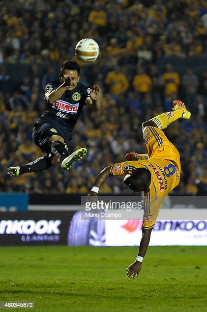 Joffre Guerron of Tigres fights for the ball with Osmar Mares of America during a Final first leg match between Tigres UANL and America as part of...