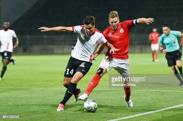 Joffrey Cuffaut of Nancy and Renaud Ripart of Nimes during the Ligue 2 match between Nimes Olympique and As Nancy Lorraine at Stade des Costieres on...