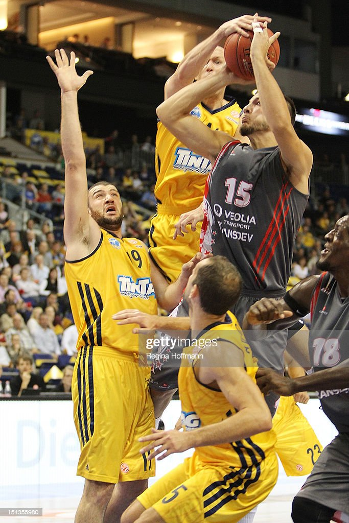 Joffrey Lauvergne #15 of Elan Chalon-sur-Saone competes with Albert Miralles #19 and <a gi-track='captionPersonalityLinkClicked' href=/galleries/search?phrase=Zach+Morley&family=editorial&specificpeople=213554 ng-click='$event.stopPropagation()'>Zach Morley</a>, #44of Alba Berlin during the 2012-2013 Turkish Airlines Euroleague Regular Season Game Day 2 between Alba Berlin v Elan Chalon-Sur-Saone at O2 World on October 18, 2012 in Berlin, Germany.