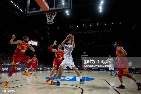 Joffrey Lauvergne of France shoots against Pau Gasol of Spain during the 2014 FIBA World Basketball Championship quarter final match between France...