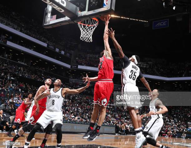 Joffrey Lauvergne of the Chicago Bulls dunks against the Brooklyn Nets during the game on April 8 2017 at Barclays Center in Brooklyn New York NOTE...