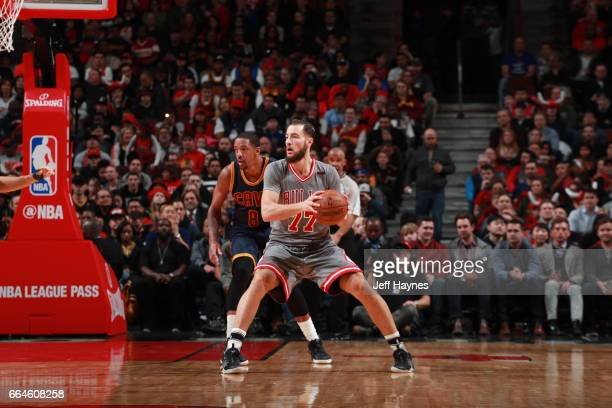 Joffrey Lauvergne of the Chicago Bulls handles the ball against the Cleveland Cavaliers on March 30 2017 at the United Center in Chicago Illinois...