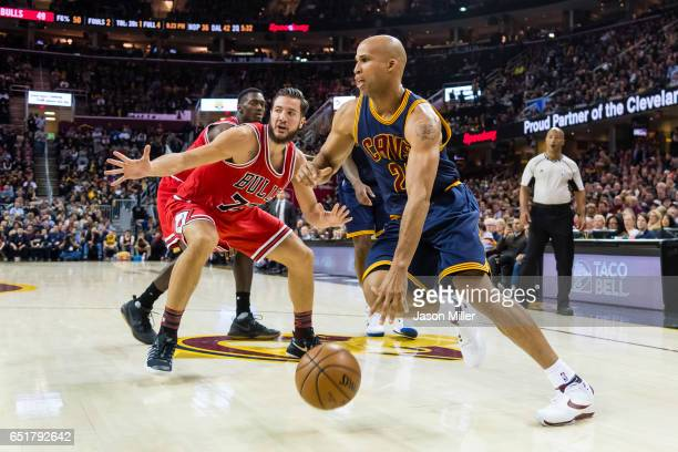 Joffrey Lauvergne of the Chicago Bulls puts pressure on Richard Jefferson of the Cleveland Cavaliers during the first half at Quicken Loans Arena on...