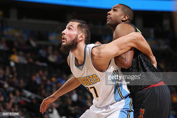 Joffrey Lauvergne of the Denver Nuggets and Al Horford of the Atlanta Hawks battle for rebounding position at Pepsi Center on January 25 2016 in...