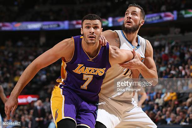 Joffrey Lauvergne of the Denver Nuggets and Larry Nance Jr #7 of the Los Angeles Lakers battle for rebounding position at Pepsi Center on December 22...