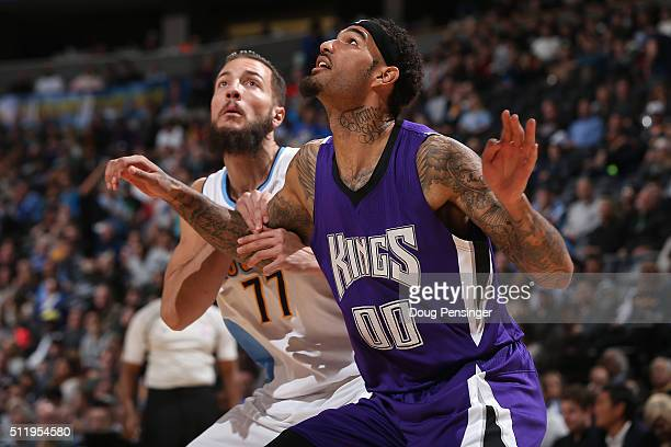 Joffrey Lauvergne of the Denver Nuggets and Willie CauleyStein of the Sacramento Kings battle for rebounding position at Pepsi Center on February 23...