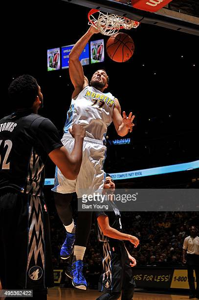 Joffrey Lauvergne of the Denver Nuggets dunks the ball against the Minnesota Timberwolves on October 30 2015 at the Pepsi Center in Denver Colorado...