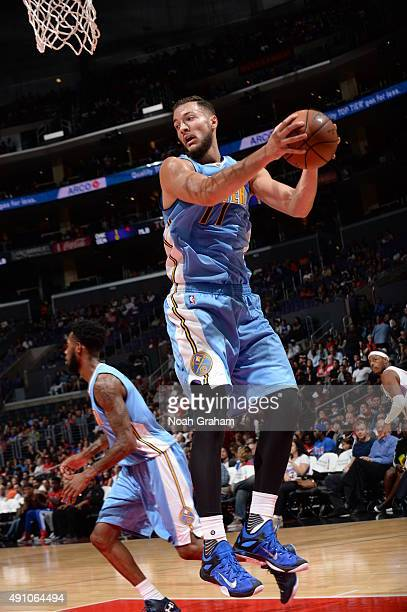 Joffrey Lauvergne of the Denver Nuggets grabs the rebound against the Los Angeles Clippers during a preseason game on October 2 2015 at STAPLES...