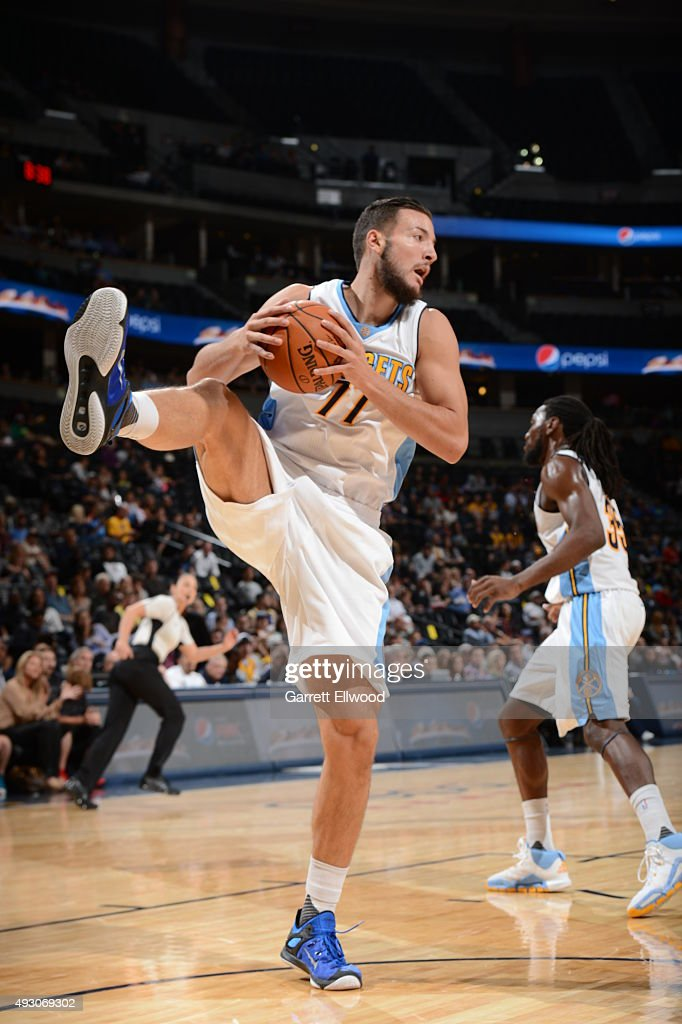 <a gi-track='captionPersonalityLinkClicked' href=/galleries/search?phrase=Joffrey+Lauvergne&family=editorial&specificpeople=6828069 ng-click='$event.stopPropagation()'>Joffrey Lauvergne</a> #77 of the Denver Nuggets grabs the rebound against the Phoenix Suns during a preseason game on October 16, 2015 at the Pepsi Center in Denver, Colorado.