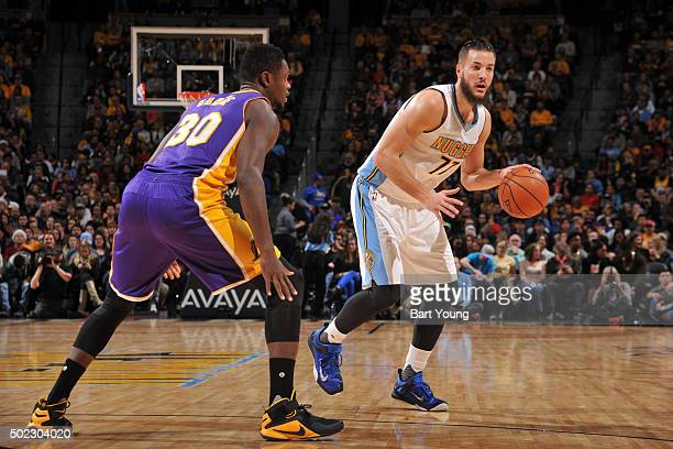 Joffrey Lauvergne of the Denver Nuggets handles the ball against Julius Randle of the Los Angeles Lakers on December 22 2015 at the Pepsi Center in...