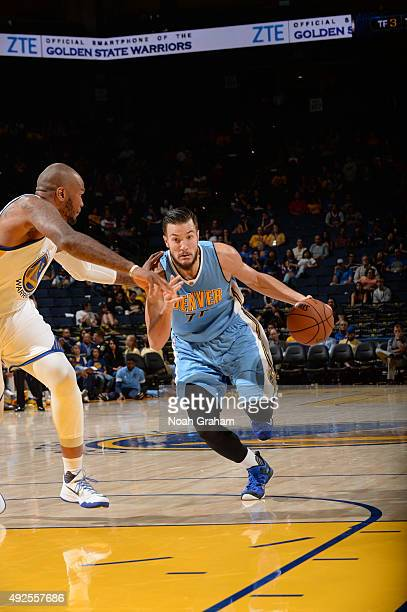 Joffrey Lauvergne of the Denver Nuggets handles the ball against the Golden State Warriors during a preseason game on October 13 2015 at ORACLE Arena...