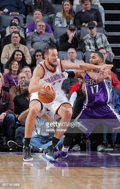 Joffrey Lauvergne of the Oklahoma City Thunder handles the ball against Garrett Temple of the Sacramento Kings on November 23 2016 at Golden 1 Center...