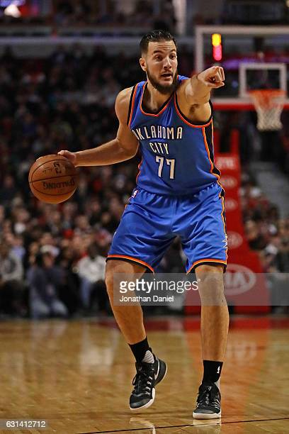 Joffrey Lauvergne of the Oklahoma City Thunder instructs a teammate against the Chicago Bulls at the United Center on January 9 2017 in Chicago...