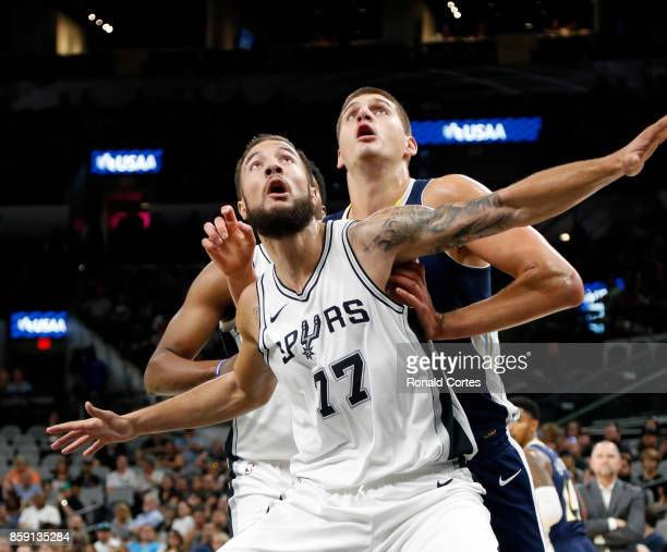 Joffrey Lauvergne of the San Antonio Spurs blocks out Nikola Jokic of the Denver Nuggets at ATT Center on October 8 2017 in San Antonio Texas NOTE TO...