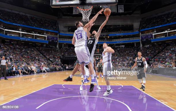 Joffrey Lauvergne of the San Antonio Spurs goes up for the shot against George Papagiannis of the Sacramento Kings on October 2 2017 at Golden 1...