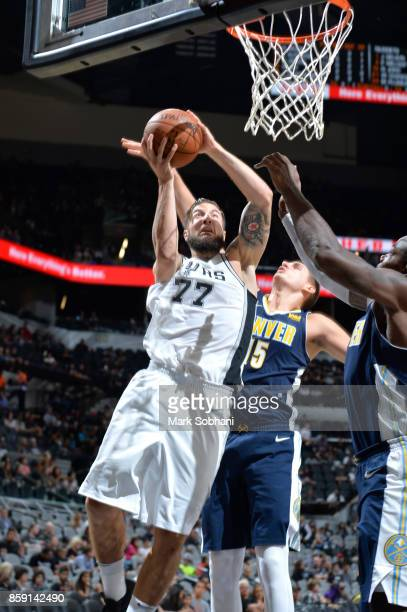 Joffrey Lauvergne of the San Antonio Spurs shoots the ball against the Denver Nuggets during the preseason game on October 8 2017 at the ATT Center...