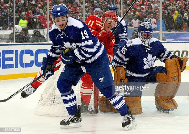 Joffrey Lupul and Jonathan Bernier of the Toronto Maple Leafs block out Daniel Alfredsson of the Detroit Red Wings during NHL game action during the...