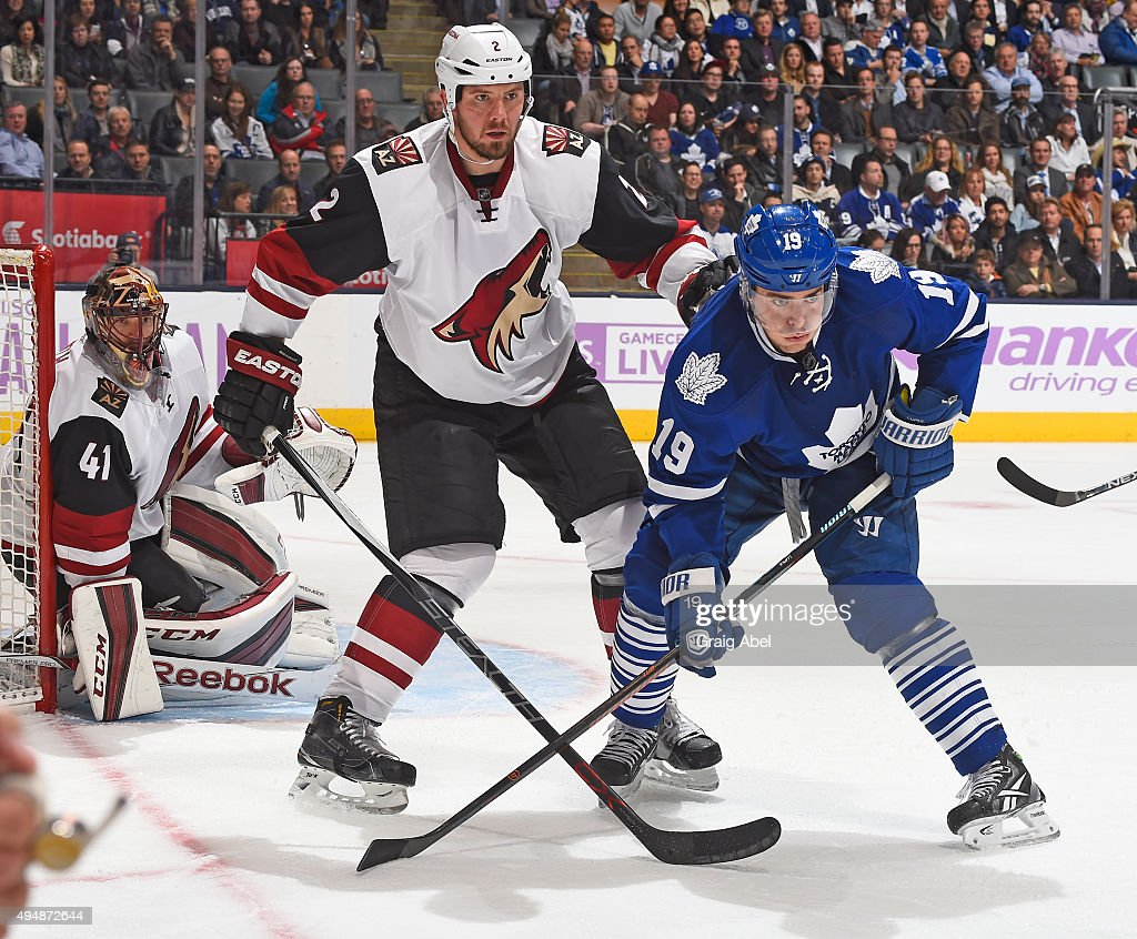 Joffrey Lupul of the Toronto Maple Leafs battles for space with Nicklas Grossmann of the Arizona Coyotes during game action on October 26 2015 at Air...