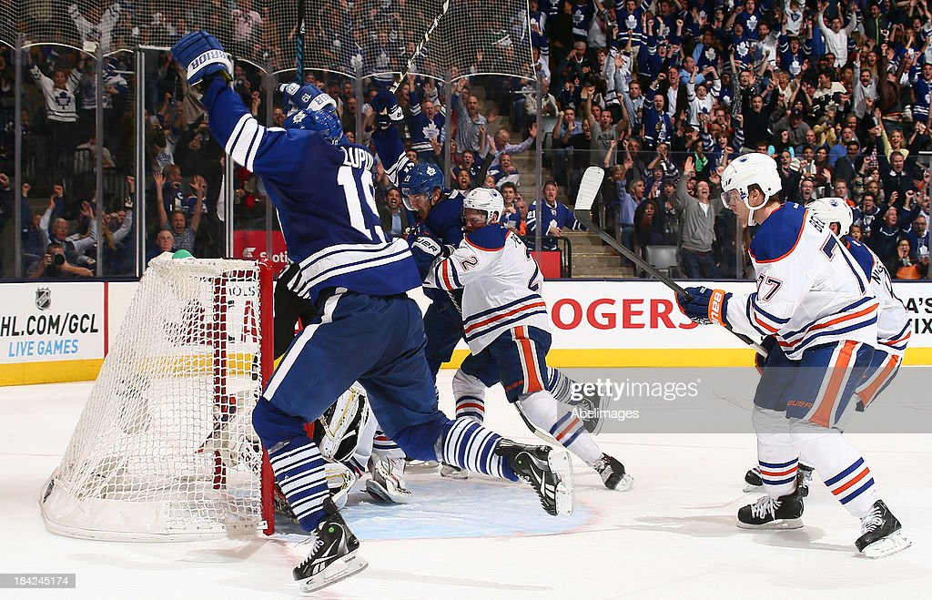 <a gi-track='captionPersonalityLinkClicked' href=/galleries/search?phrase=Joffrey+Lupul&family=editorial&specificpeople=206995 ng-click='$event.stopPropagation()'>Joffrey Lupul</a> #19 of the Toronto Maple Leafs celebrates his goal against <a gi-track='captionPersonalityLinkClicked' href=/galleries/search?phrase=Devan+Dubnyk&family=editorial&specificpeople=2089794 ng-click='$event.stopPropagation()'>Devan Dubnyk</a> #40 of the Edmonton Oilers during NHL action at the Air Canada Centre October 12, 2013 in Toronto, Ontario, Canada.