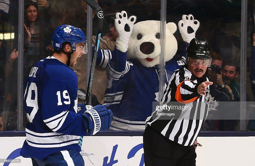 <a gi-track='captionPersonalityLinkClicked' href=/galleries/search?phrase=Joffrey+Lupul&family=editorial&specificpeople=206995 ng-click='$event.stopPropagation()'>Joffrey Lupul</a> #19 of the Toronto Maple Leafs celebrates his goal against Devan Dubnyk #40 of the Edmonton Oilers during NHL action at the Air Canada Centre October 12, 2013 in Toronto, Ontario, Canada.