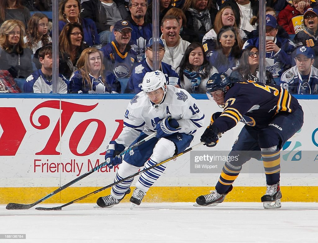 <a gi-track='captionPersonalityLinkClicked' href=/galleries/search?phrase=Joffrey+Lupul&family=editorial&specificpeople=206995 ng-click='$event.stopPropagation()'>Joffrey Lupul</a> #19 of the Toronto Maple Leafs controls the puck against <a gi-track='captionPersonalityLinkClicked' href=/galleries/search?phrase=Tyler+Myers&family=editorial&specificpeople=4595080 ng-click='$event.stopPropagation()'>Tyler Myers</a> #57 of the Buffalo Sabres on November 15, 2013 at the First Niagara Center in Buffalo, New York. Buffalo won, 3-1.