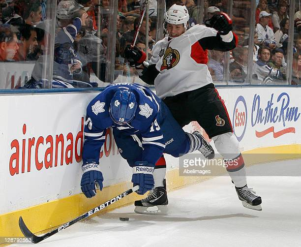 Joffrey Lupul of the Toronto Maple Leafs gets hit by Zack Smith of the Ottawa Senators during NHL action at the Air Canada Centre October 8 2011 in...