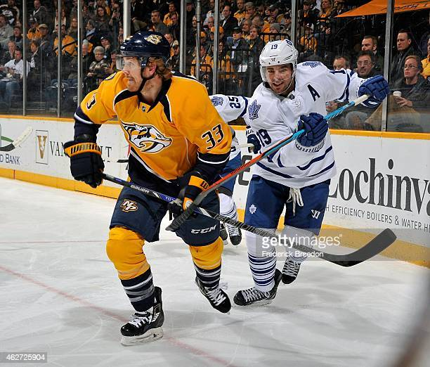 Joffrey Lupul of the Toronto Maple Leafs hooks the stick of Colin Wilson of the Nashville Predators during the second period of a game at Bridgestone...
