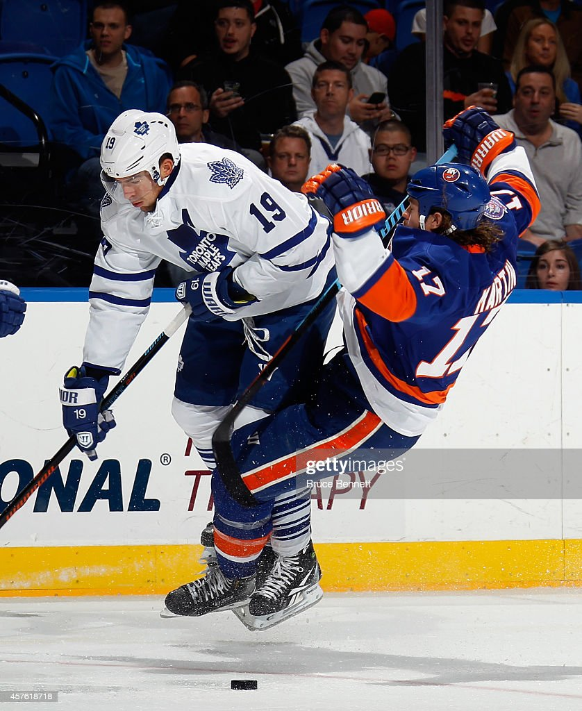 <a gi-track='captionPersonalityLinkClicked' href=/galleries/search?phrase=Joffrey+Lupul&family=editorial&specificpeople=206995 ng-click='$event.stopPropagation()'>Joffrey Lupul</a> #19 of the Toronto Maple Leafs issues a hard check to Matt Martin #17 of the New York Islanders during the first period at the Nassau Veterans Memorial Coliseum on October 21, 2014 in Uniondale, New York.