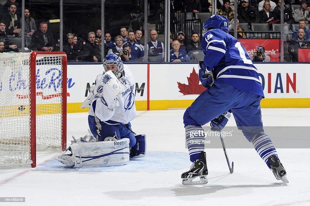 Joffrey Lupul #19 of the Toronto Maple Leafs scores a first period goal on Mathieu Garon #32 of the Tampa Bay Lightning during NHL game action March 20, 2013 at the Air Canada Centre in Toronto, Ontario, Canada.
