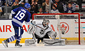 Joffrey Lupul of the Toronto Maple Leafs scores the game winning goal in the shootout on Jonathan Quick of the Los Angeles Kings during NHL game...