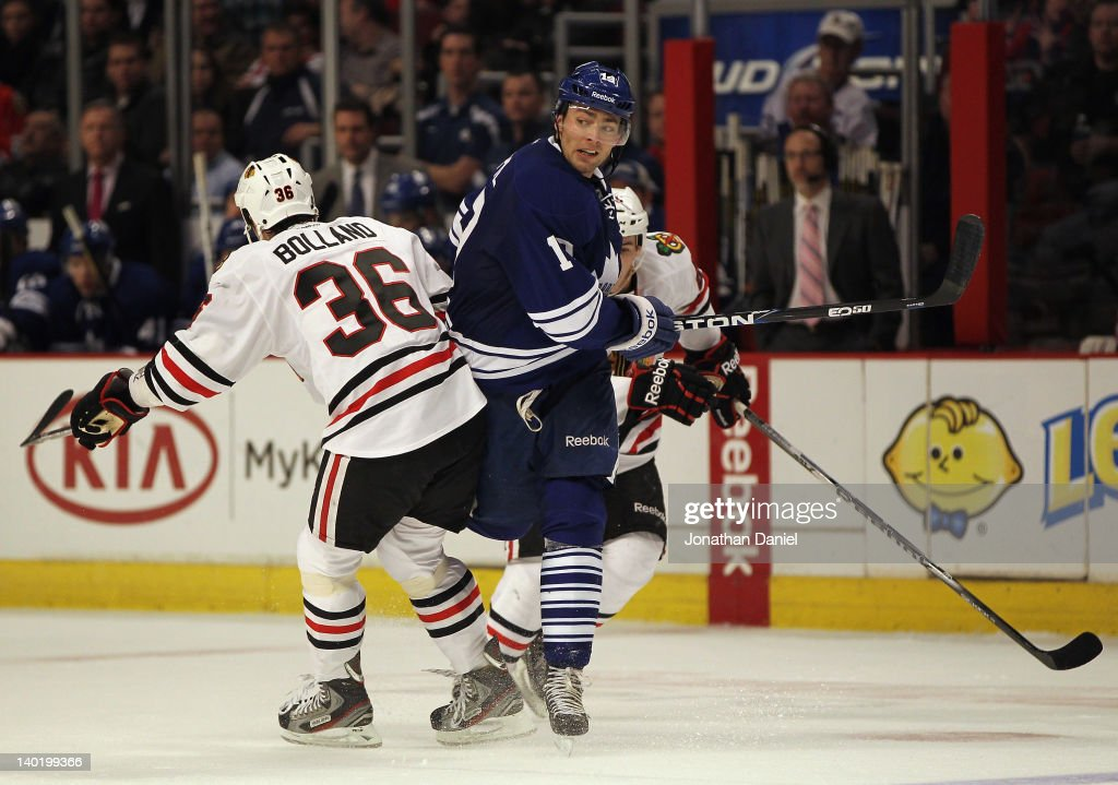 Joffrey Lupul of the Toronto Maple Leafs squeezes between Dave Bolland and Andrew Shaw of the Chicago Blackhawks at the United Center on February 29...