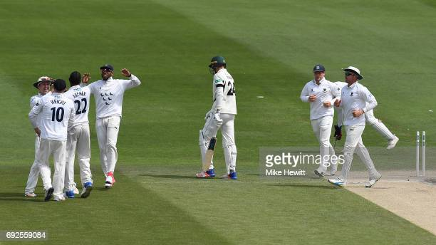 Jofra Archer of Sussex celebrates with team mates Chris Nash Luke Wright and Chris Jordan after clean bowling Josh Tongue of Worcestershire during...