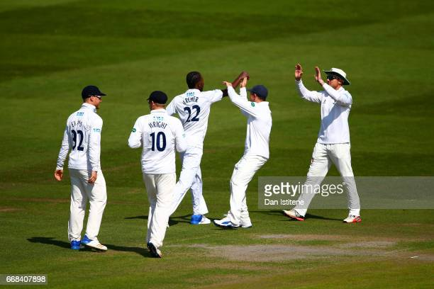 Jofra Archer of Sussex celebrates with teammates after claiming the wicket of Daniel BellDrummond of Kent during day one of the Specsavers County...