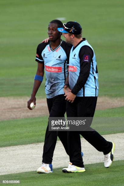 Jofra Archer of Sussex Sharks is congratulated by captain Chris Nash after taking the wicket of Matt Coles of Kent Spitfires during the match between...