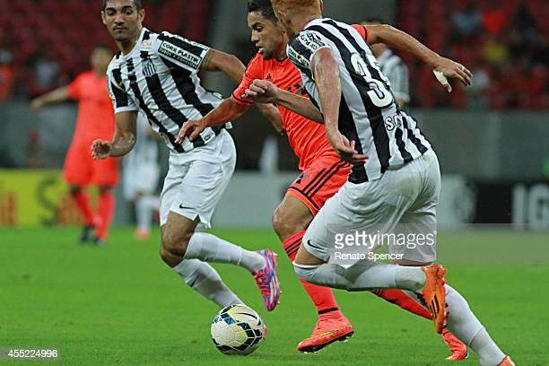 Jogador of Sport Recife battles for the ball with jogador of Santos during the Brasileirao Series A 2014 match between Sport Recife and Santos at...