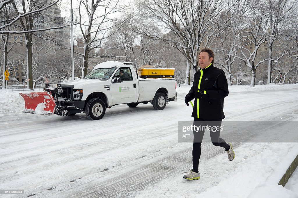 A jogger in Central Park braves the weather after winter storm Nemo covered New York City with 4 to 8 inches (10-20cms) of snow on February 9, 2013. The storm was forecast to bring the heaviest snow to the densely-populated northeast corridor so far this winter, threatening power and transport links for tens of millions of people and the major cities of Boston and New York. New York and other regional airports saw more than 4,500 cancellations ahead of what the National Weather Service called 'a major winter storm with blizzard conditions' along most of the region's coastline.