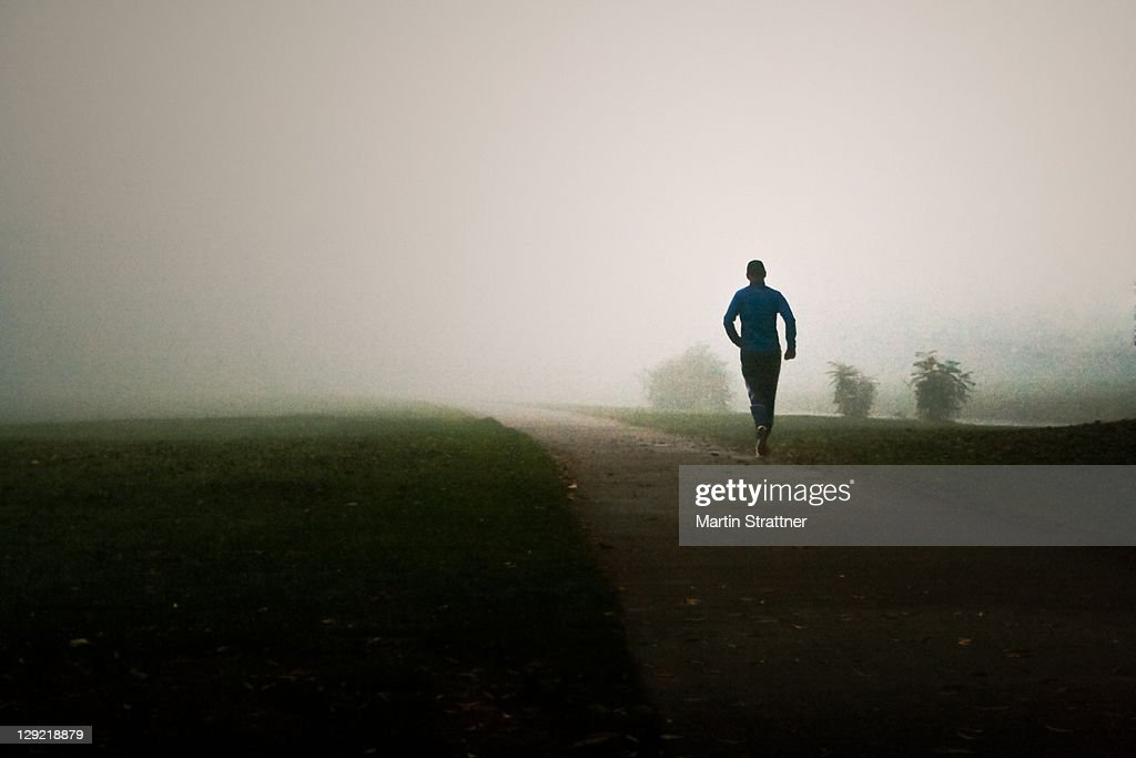 Jogger in fog : Stock Photo