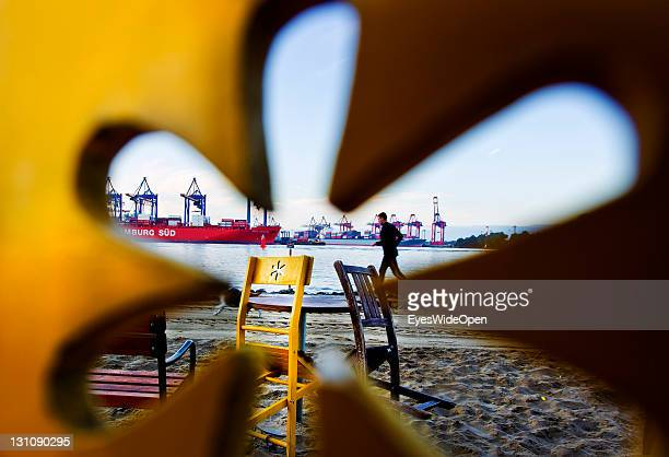 A jogger in the morning at the beach Ovelgonne on the river Elbe on September 16 2011 in Hamburg GermanyThe beach has a beautiful view on the famous...