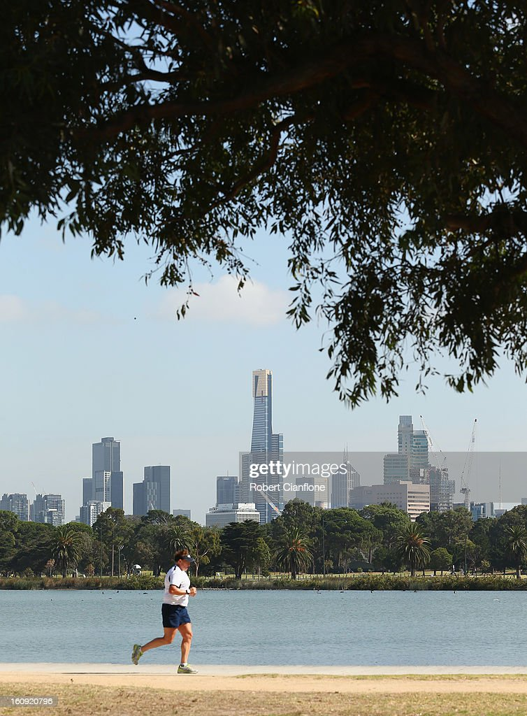 A jogger is seen as the circuit is prepared for the Australian Formula One grand Prix at Albert Park, on February 8, 2013 in Melbourne, Australia.