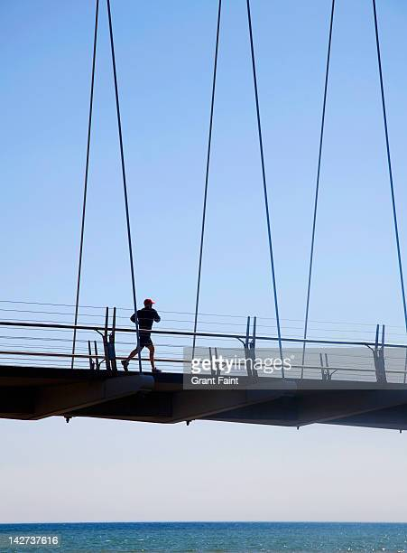 Jogger on bridge.