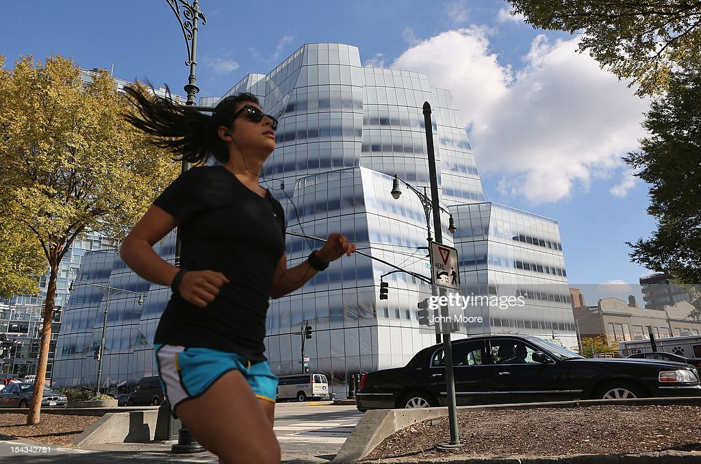 A jogger passes by the offices of Newsweek Magazine in the Frank Gehry-designed IAC Building in Manhattan's Chelsea neighborhood on October 18, 2012 in New York City. Tina Brown, editor-in-chief of The Newsweek Daily Beast Co, announced today that the 80-year-old news magazine will publish its final print edition on December 31 and shift to an all-digital format in early 2013. Staff layoffs are expected.