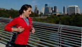 A jogger passes near the Houston skyline during the afternoon on March 26 2013 in Houston Texas
