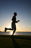 Jogger running at Sunset
