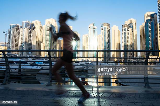 Jogger running round Dubai Marina