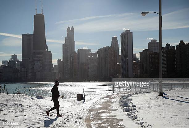 A jogger runs along the lakefront despite singledigit temperatures on December 15 2016 in Chicago Illinois The Chicago area is experiencing the...