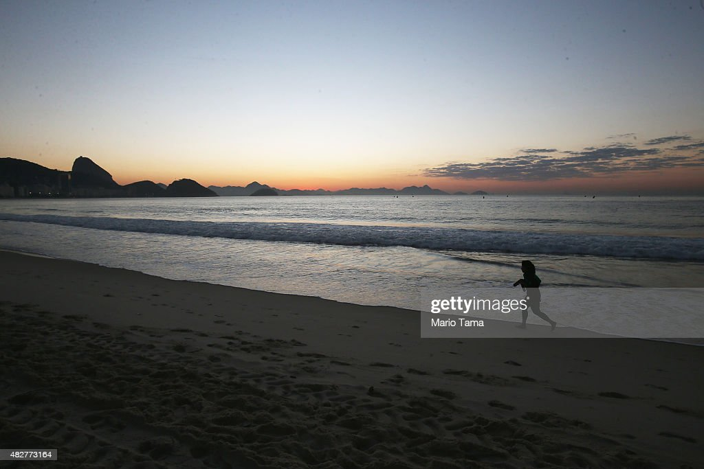 A jogger runs before the Aquece Rio Triathlon Olympic Qualifier at Copacabana beach ahead of the Rio 2016 Olympic Games on August 2 2015 in Rio de...